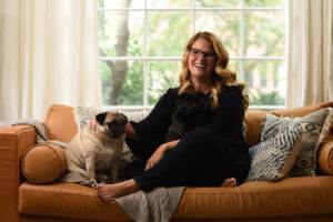 Amy Pottenger smiling with her dogs