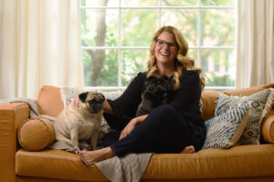 Amy Pottenger Refresh Design sitting couch dogs laughing