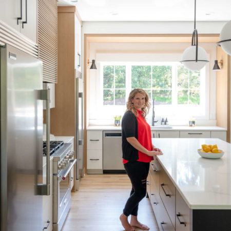 woman standing in remodeled kitchen design